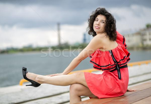 Woman in dress stroking leg Stock photo © vetdoctor