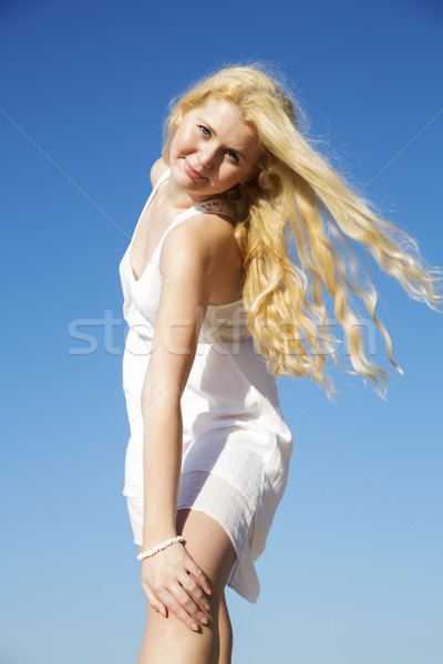 Posing woman in white dress with hairs Stock photo © vetdoctor