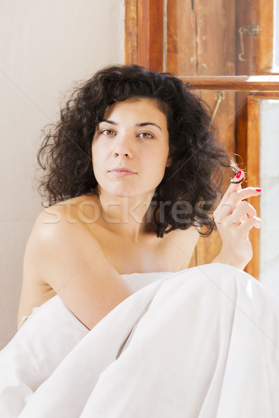 Pretty woman play with hair between bedclothes Stock photo © vetdoctor