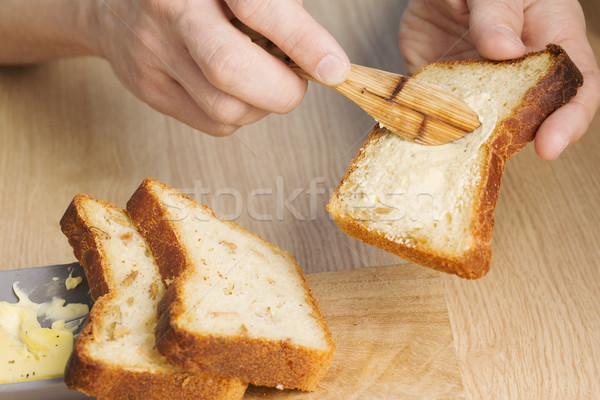 Butter spread on bread slice at breakfast Stock photo © vetdoctor