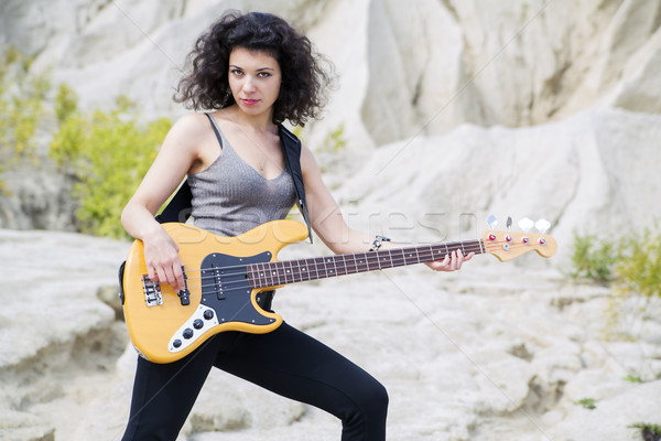 Woman play famous song on bass guitar Stock photo © vetdoctor