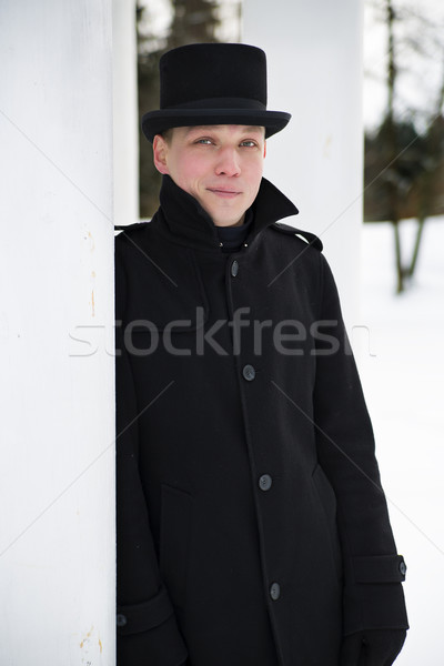 Man in hat relies on white column Stock photo © vetdoctor