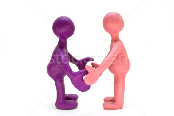 Colored plasticine puppets standing opposite each other Stock photo © vetdoctor