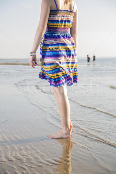 Woman in dress walking on sea shore Stock photo © vetdoctor