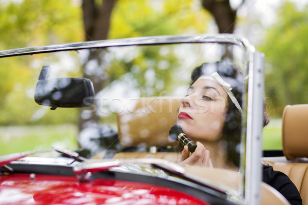 Woman adjust face before mirror at car Stock photo © vetdoctor