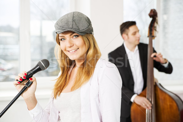 Woman with microphone and man contrabas Stock photo © vetdoctor