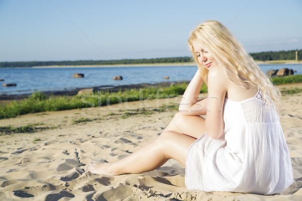Woman in white dress indulgence on beach Stock photo © vetdoctor