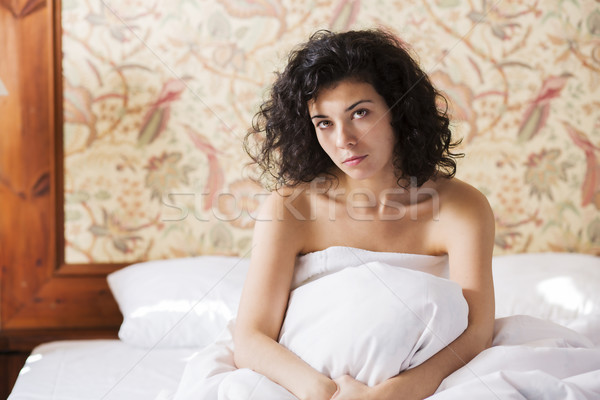 Woman sit calmly in bed after night Stock photo © vetdoctor