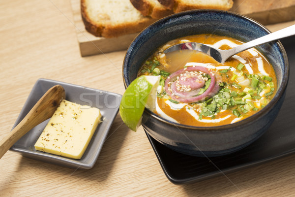 Bowl with soup and chromed spoon Stock photo © vetdoctor