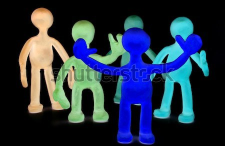 Shaded plasticine puppets standing on black background Stock photo © vetdoctor