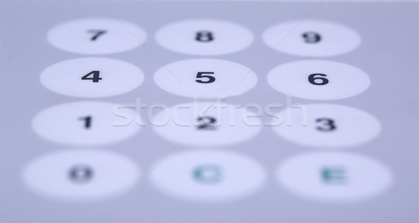 White buttons on working desktop partially shaded Stock photo © vetdoctor
