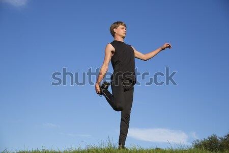 Sportsman is stretch right leg crook behind Stock photo © vetdoctor