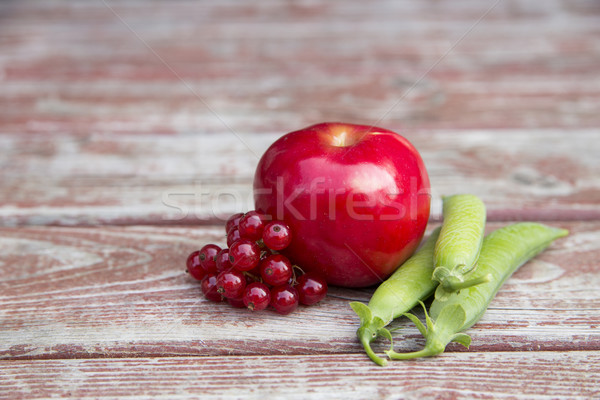 Ripe foxberry red apple and pea pods Stock photo © vetdoctor
