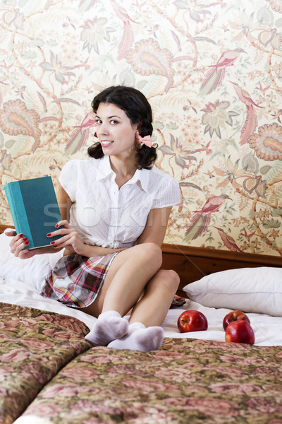 Woman in schoolgirl dress with mysterious book Stock photo © vetdoctor
