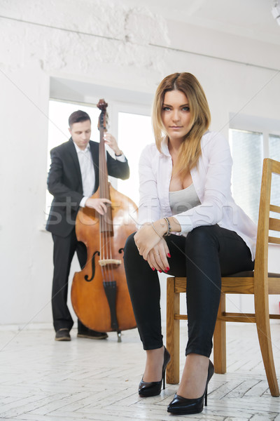 Woman on chair and man plays melody Stock photo © vetdoctor