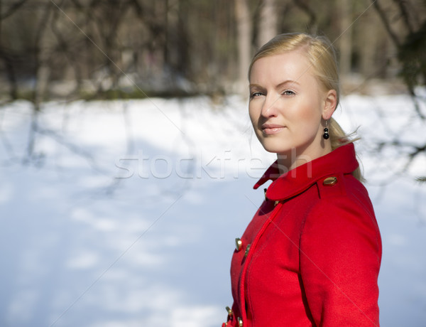 Woman in red coat with firmly look Stock photo © vetdoctor