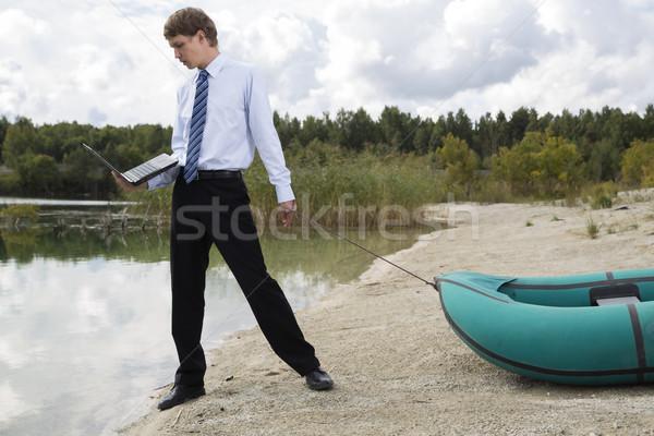 Homem plano barco lago superfície negócio Foto stock © vetdoctor