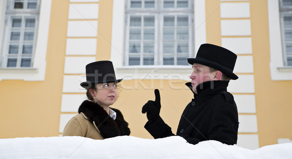 Man telling something to woman near house Stock photo © vetdoctor