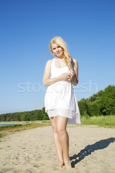 Thinking woman in white dress with hairs Stock photo © vetdoctor