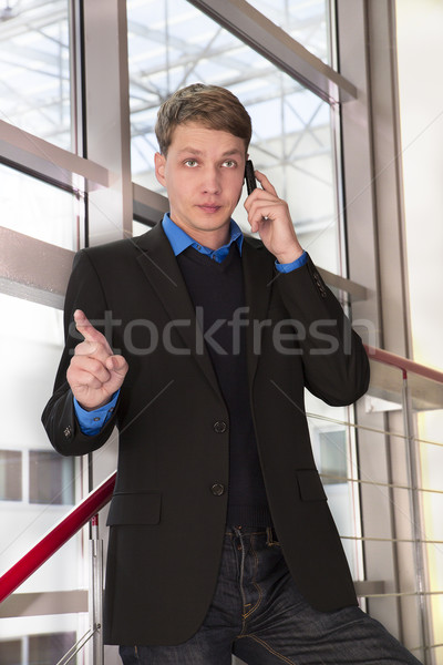 Businessman seriously talking with employees by telephone Stock photo © vetdoctor