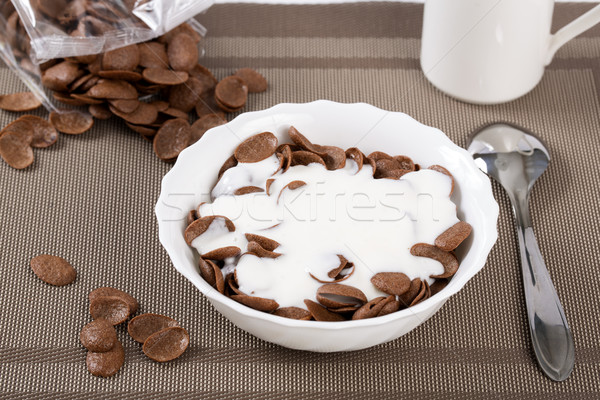 Flakes in bowl sinking in sour cream Stock photo © vetdoctor