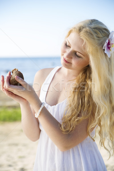 Woman in dress marvel clam at hands Stock photo © vetdoctor