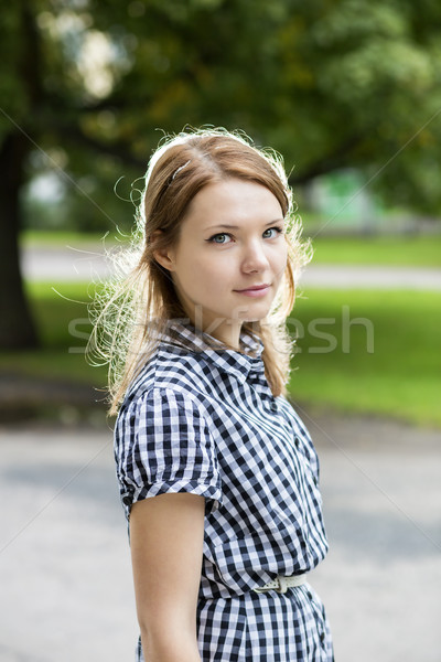 Portrait of woman in blue checkered dress Stock photo © vetdoctor