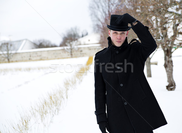 Young man put hat back Stock photo © vetdoctor