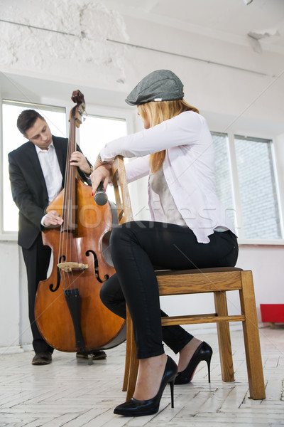 Woman backwards on chair listen contrabass play Stock photo © vetdoctor