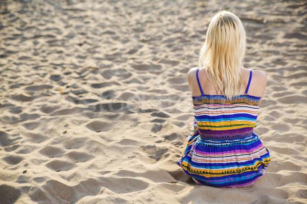 Woman in dress looking at calm sea Stock photo © vetdoctor