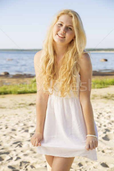 Smiling woman in white dress with hairs Stock photo © vetdoctor