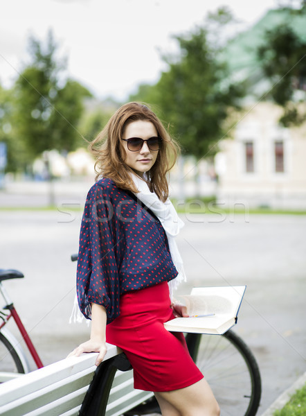 Woman rests on bench and hold book Stock photo © vetdoctor