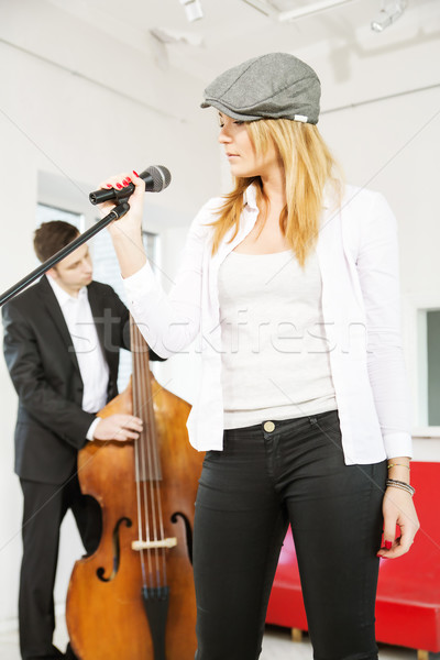 Woman configures microphone and contrabas Stock photo © vetdoctor
