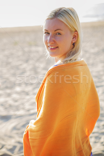 Woman coated in scarf standing on beach Stock photo © vetdoctor