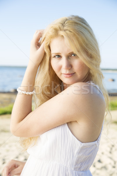 Portrait of woman in dress adjusts hairs Stock photo © vetdoctor