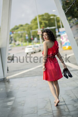 Woman in red dress walking barefoot Stock photo © vetdoctor