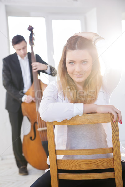 Woman backwards on wooden chair fondled hairs Stock photo © vetdoctor