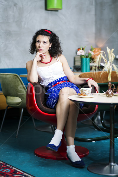 Woman on chair in café thinking Stock photo © vetdoctor