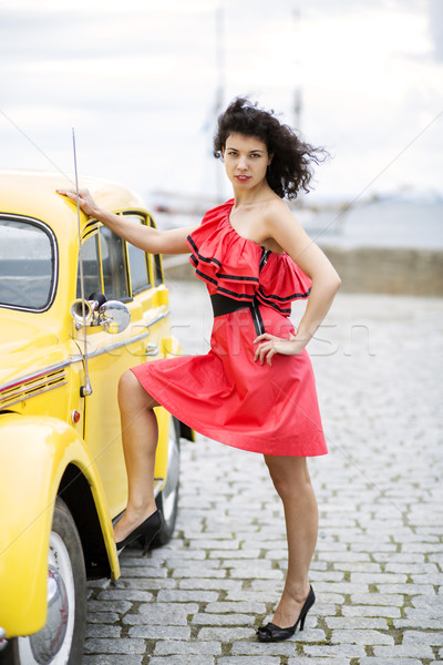 Woman in dress rely leg on car Stock photo © vetdoctor