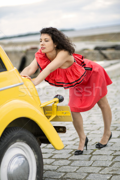 Woman in red dress pushing lightly car Stock photo © vetdoctor