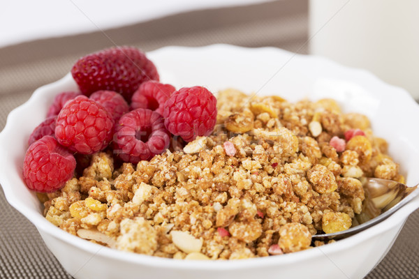 Zoomed shapy cereals with berries with spoon Stock photo © vetdoctor