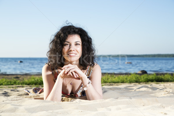 Happy woman with hairs lying at beach Stock photo © vetdoctor