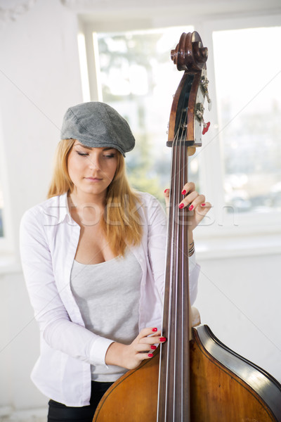 Woman at sunny day hold on contrabas Stock photo © vetdoctor