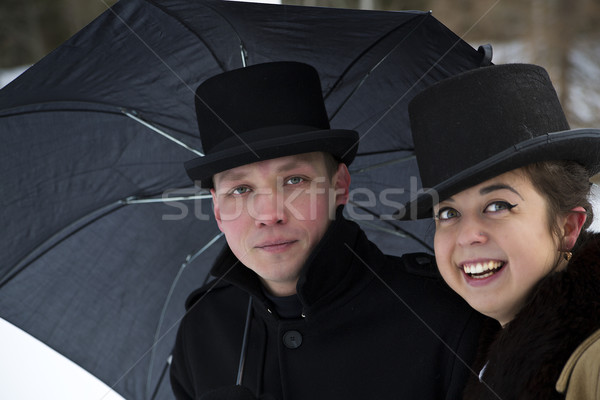 Tired man and happy woman under umbrella Stock photo © vetdoctor
