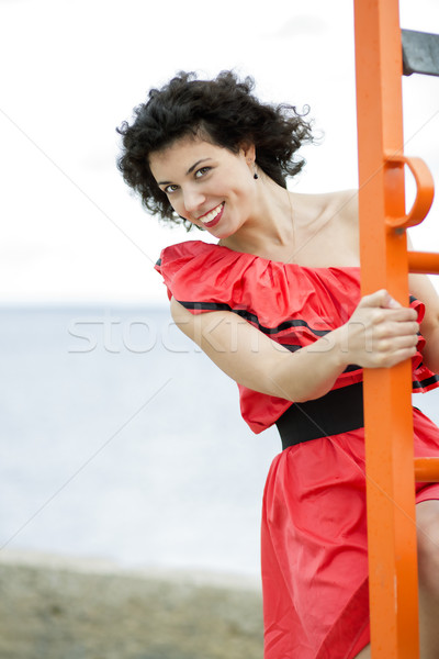 Mulher vestido vermelho escada laranja modelo verão Foto stock © vetdoctor