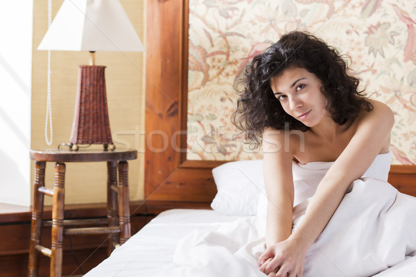 Woman stretches herself in bed after night Stock photo © vetdoctor