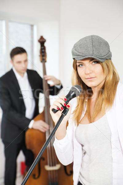 Mulher microfone homem música moda fundo Foto stock © vetdoctor