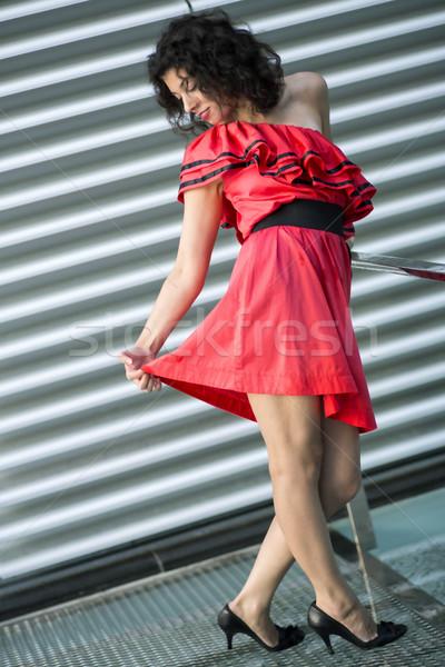 Woman in nice dress look carefully skirt Stock photo © vetdoctor