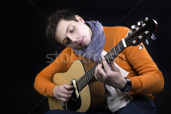 Man on background play on guitar. Stock photo © vetdoctor