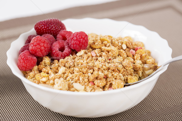 Stock photo: Zoomed golden cereals with berries with spoon